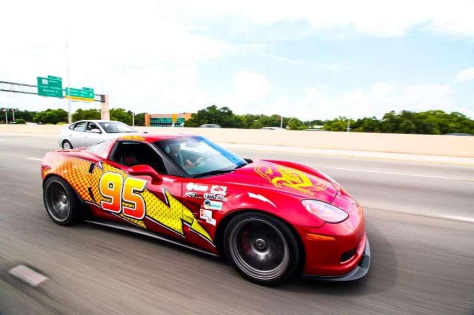 The Lightning McQueen Corvette on the road.