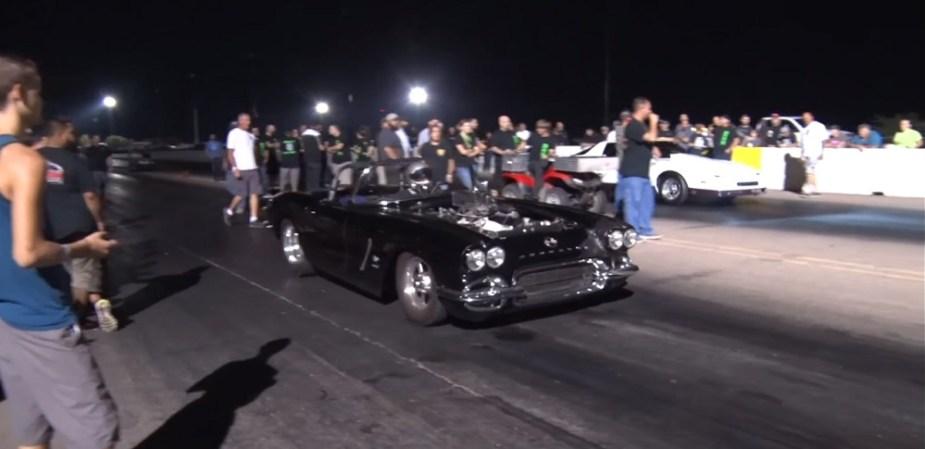 C1 Corvette tearing up the drag strip.