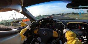 Corvette Passed by Ferrari