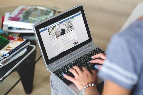 using facebook on laptop