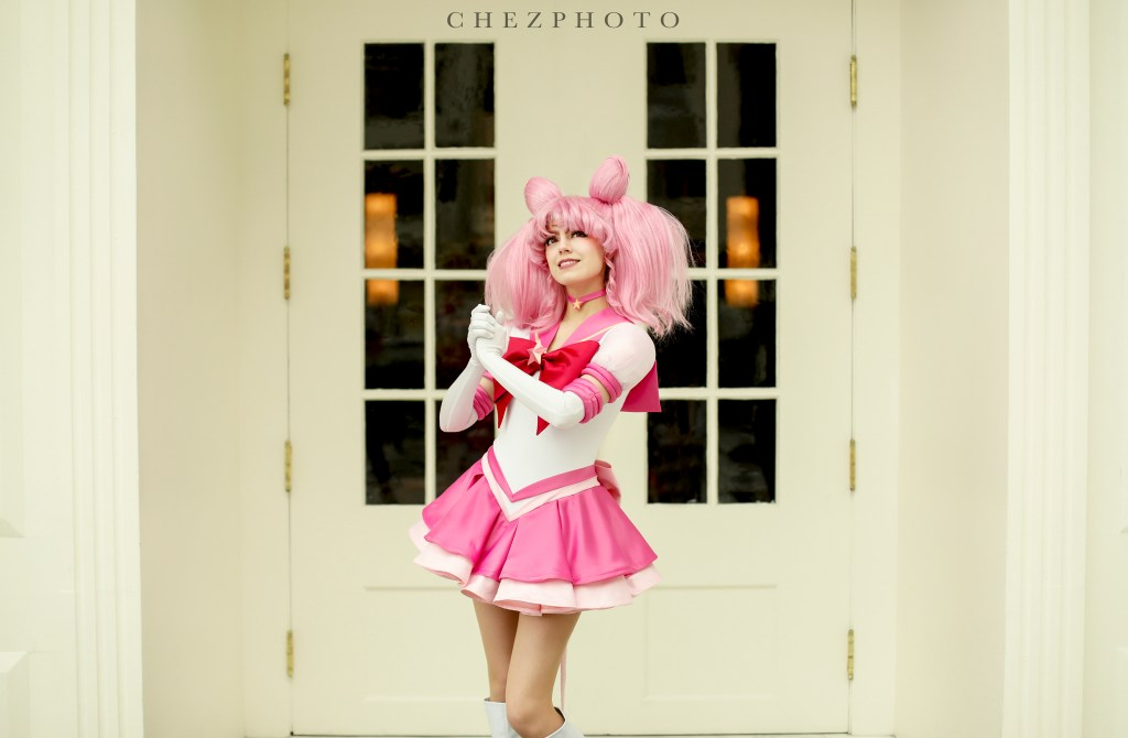 Cosplayer Koholint as Eternal Sailor Chibimoon poses with her hands clasped before her, looking into the distance.