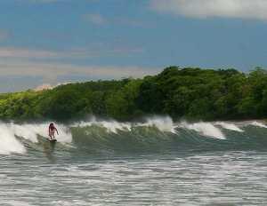 Sufing a point break in the Montezuma/Malpais area