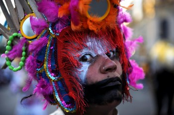 A  woman performs during the Light Festival Parade Christmas celebrations in San Jose, on December 2009. The festival, promoted by the municipality, was dedicated to the environment with a call to take action for climate change.   AFP PHOTO / Yuri CORTEZ (Photo credit should read YURI CORTEZ/AFP/Getty Images)