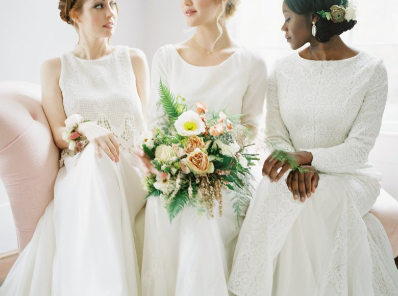 Pop Up Bridal Models Sitting with Flowers