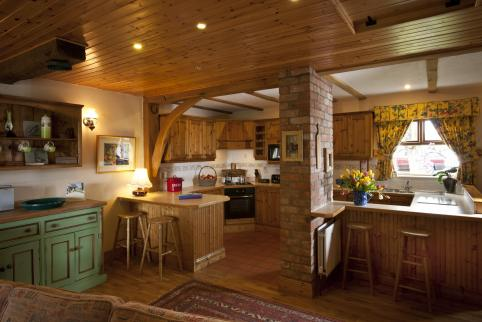 Apple Loft Cottage open plan farm house style kitchen.