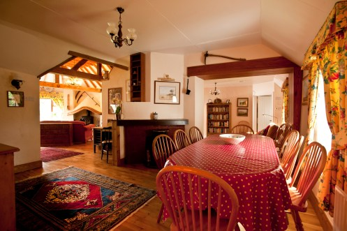 The dining room in Little Orchard Cottage with a view to living area and snug