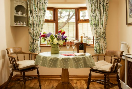 Intimate dining area in Honeymoon Cottage