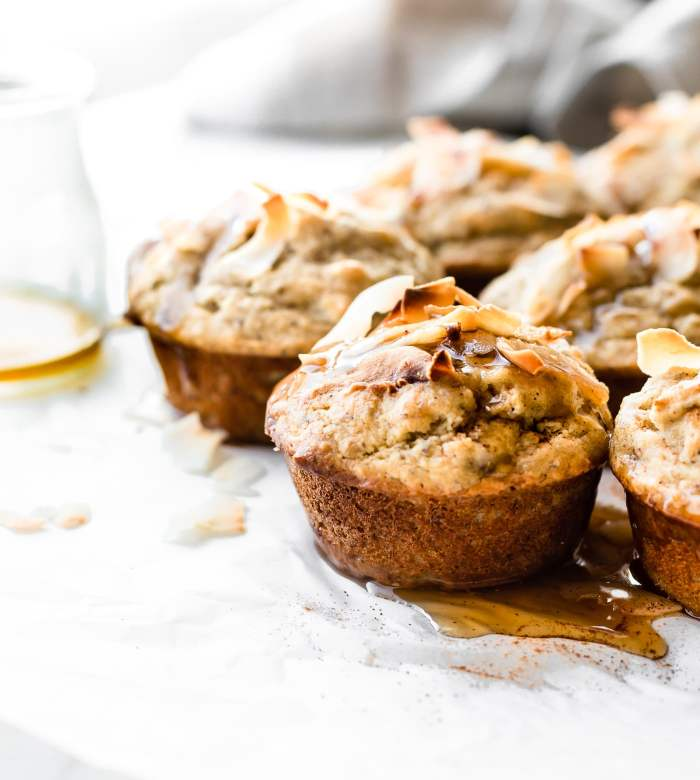 Lightly Sweetened Paleo Banana Bread Muffins with Toasted Coconut. These Banana Muffins are quick to make and delicious! Refined sugar free, soft, fluffy, and addicting.