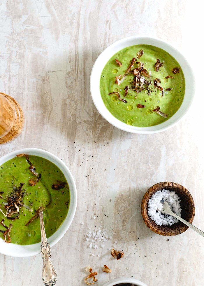 This easy creamy broccoli soup is rich, comforting and topped with crispy shallots. It's also paleo, gluten free, vegetarian and vegan!