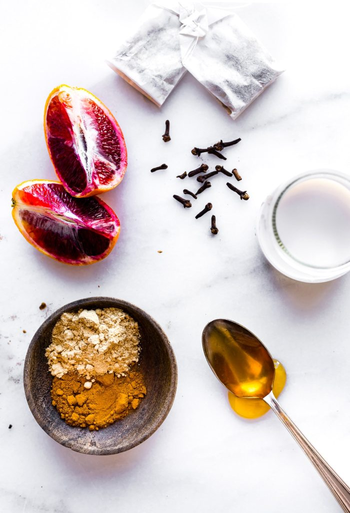 """Boost your health with a cold busting blood orange turmeric tea latte! This Vegan """"Golden Milk"""" latte is loaded with extra Vitamin C, rich in minerals, and anti-inflammatory properties. A fruit sweetened spiced latte that's warming and nourishing! Paleo friendly."""