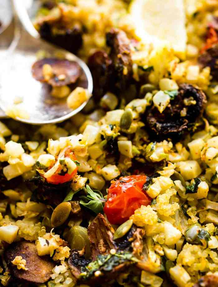 Dukkah roasted Vegetables mixed together on pan with herbs.