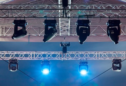 Bright bluespotlights on stage