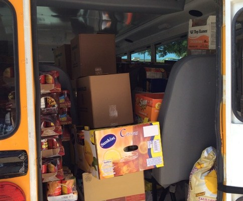 Photo of Island Pacific Academy Bus with Food Drive Items