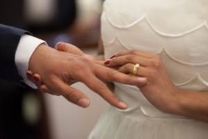 couples counseling bride puts ring on groom