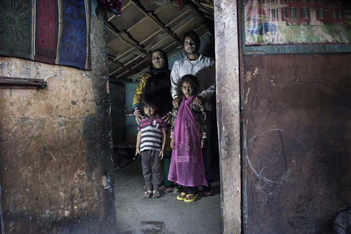"Rohit Sisodia (32), along with her wife, Sunita (30) and two children. His occupation as a blacksmith suffered a lot after the demolishment.""No one comes here, away from the road to this settlement for getting their job done.They usually hire roadside blacksmiths,"" says Rohit"