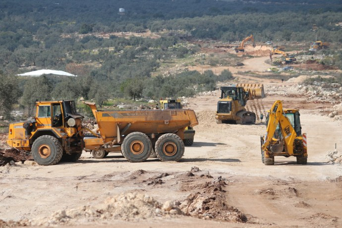 sraeli bulldozers work on a new Israeli settler road, in Nabi Elias village, in the occupied West Bank, on 6 February. Some 700 olive trees were uprooted from private Palestinian land to build the road. Ahmad Al-Bazz ActiveStills