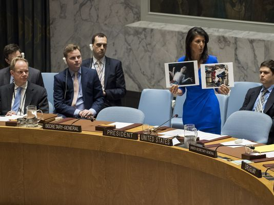 NIKKI-HALEY-holds-syria-photos