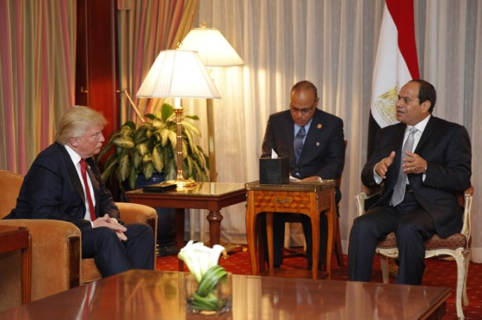 Republican presidential candidate Donald Trump (L) looks on as Egyptian President Abdel Fattah el-Sisi speaks during a meeting at the Plaza Hotel on September 19, 2016 in New York. / AFP PHOTO / DOMINICK REUTER