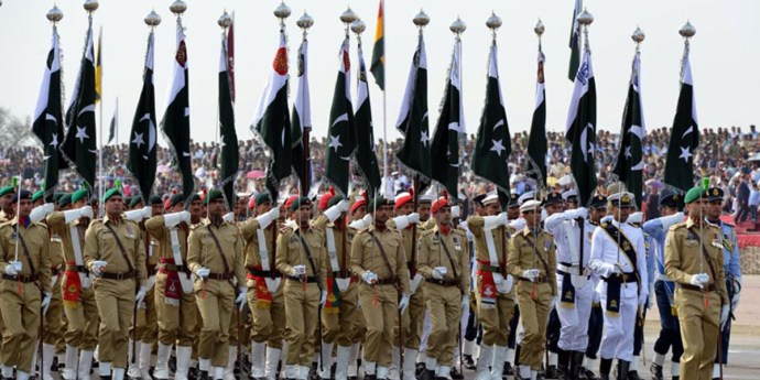 ISLAMABAD: Personnel of Armed Forces march-past during full dress rehearsal of Pakistan Day parade. INP PHOTO
