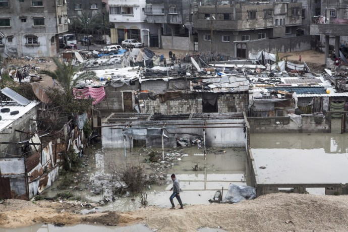 A flooded quarter in northern Gaza's Jabaliya refugee camp, February 2017. Gaza's beleaguered sewage system is overwhelmed during heavy rains, causing flooding and forcing families to evacuate from their homes. Anne Paq ActiveStills