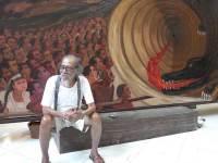 Djokopekik in front of his Papuan painting