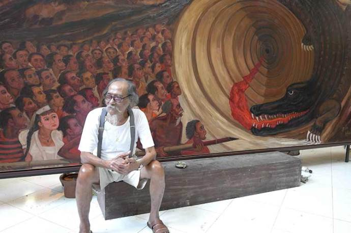 Djokopekik in front of his Papuan painting