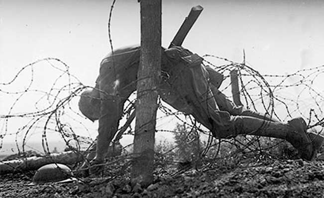 An American soldier lies dead, tangled in barbed wire on the western front. Photograph: American Stock Archive/Getty Images