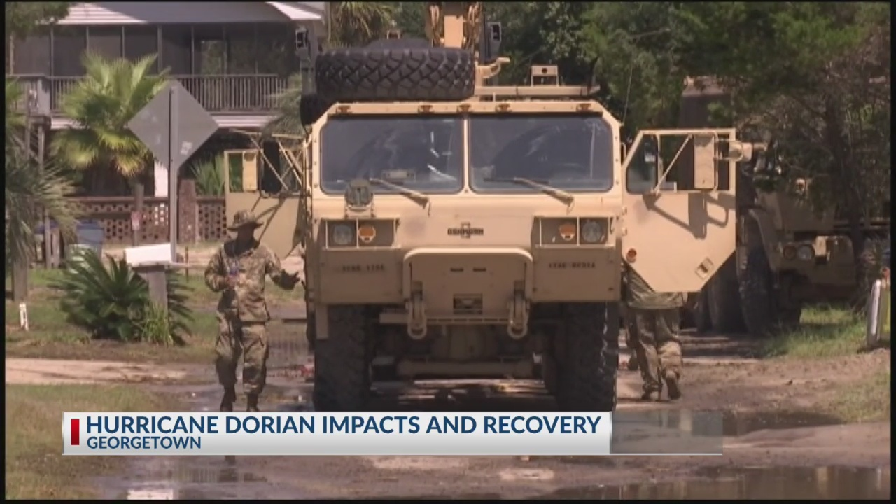Dorian's floodwaters trap people in attics in North Carolina