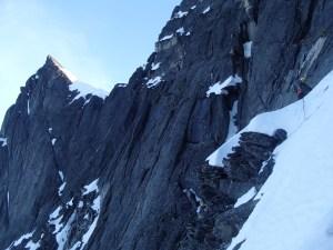 Len traversing the snow ledge