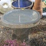 A short granite bird bath