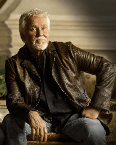 Kenny Rogers signs long-term exclusive recording contract with Warner Bros. Records