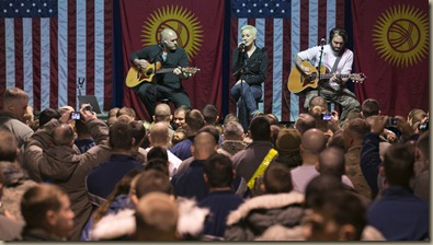 Critically acclaimed country music singer Kellie Pickler (c ), David Baker (r ) and Kyle Jacobs (l) perform a USO show for troops as part of the 2012 USO Holiday tour led by General Martin Dempsey, Chairman, Joint Chiefs of Staff on December 14, 2012.  Pickler along with other entertainers and athletes are making multiple stops on the week-long tour. USO photo by Fred Greaves