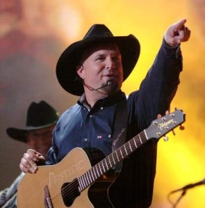 Garth Brooks head to set out on a world tour in 2014
