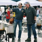 Tracy Lawrence gets help from Lee Greenwood and others at turkey fry for Nashville Rescue Mission