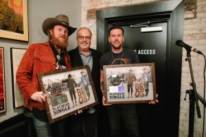 "Brothers Osborne surprised with Platinum plaque for Grammy-nominated No. 1 hit ""Stay a Little Longer"" at sold-out Nashville show"