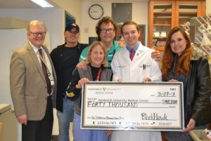 BlackHawk and The Outlaws present checks to Vanderbilt and MusiCares