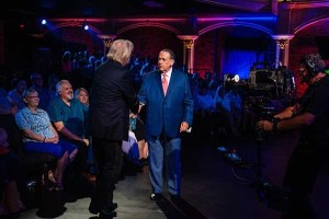 The Oak Ridge Boys' Duane Allen Presents Liberty Legends USA suit to Gov. Mike Huckabee during latest airing of HUCKABEE on TBN