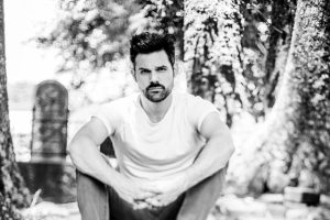 One Vision Music Group expands artist roster with risingcountry singer-songwriter Cody Belew