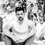 One Vision Music Group expands artist roster with rising country singer-songwriter Cody Belew