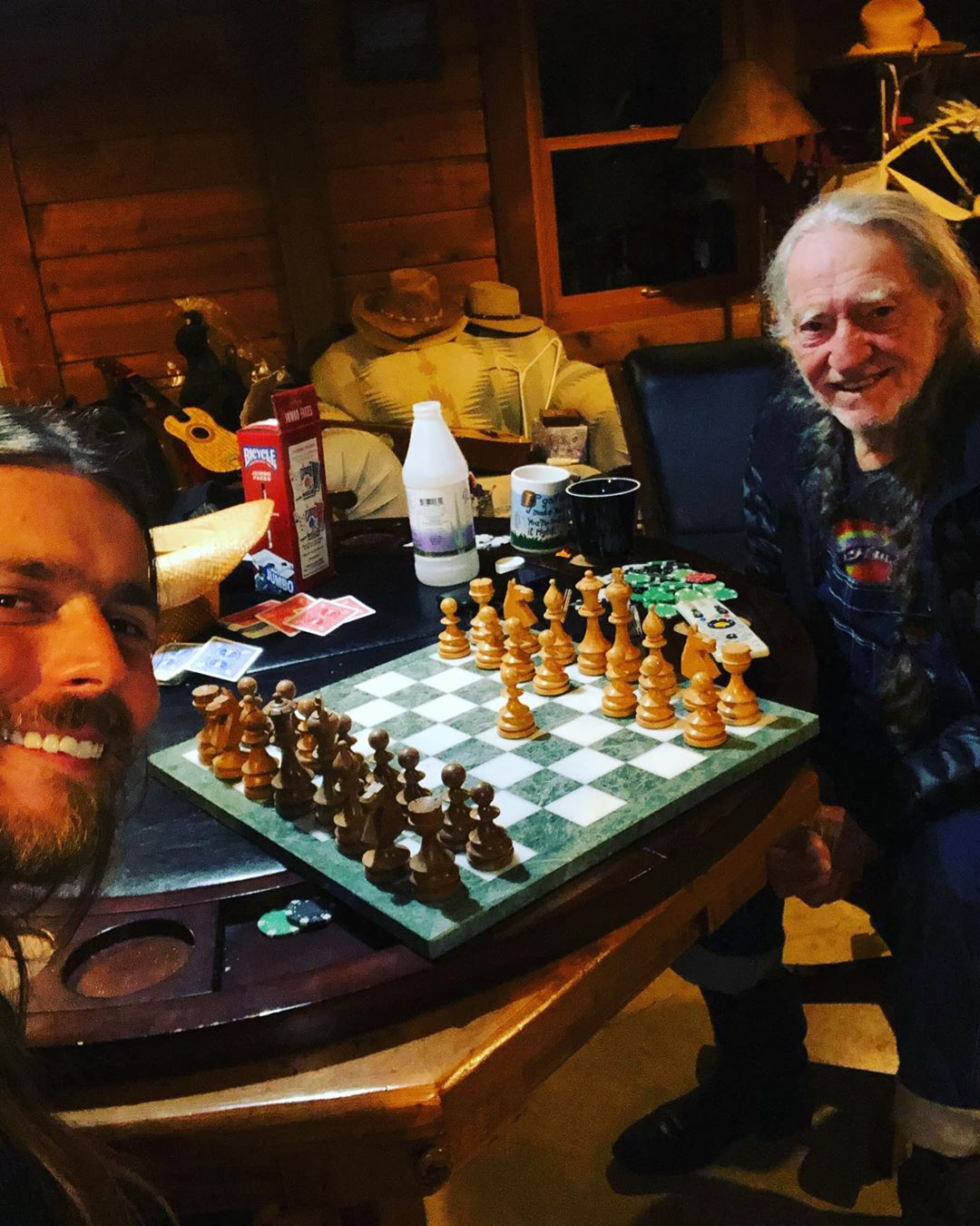Lukas Nelson and Willie Nelson playing chess