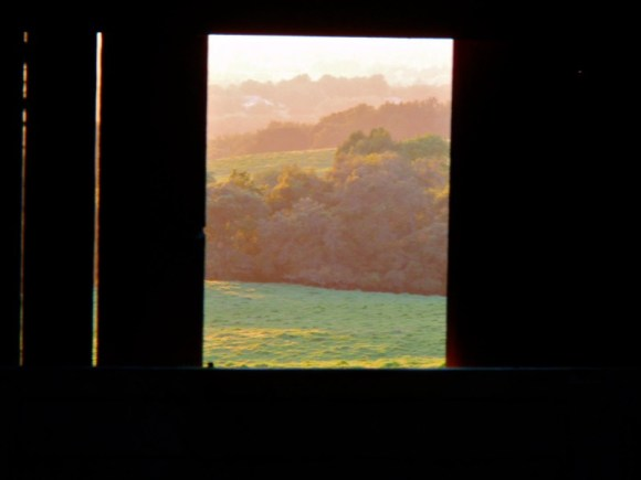 Through the Barn Window into Sunset