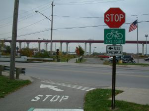 photo of street signs with bike route