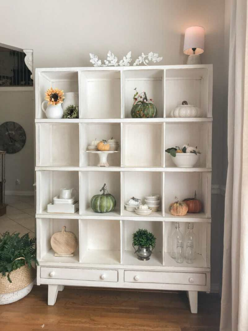 white cubby shelf with colorful fall decor