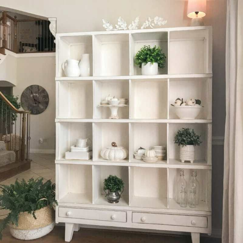 white cubby shelf with white fall decor
