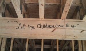 Let the Children Come to me written on the frame work of the New Samaritian House in Jefferson City, TN