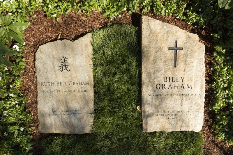 ": A slab of North Carolina stone marks the grave of Billy Graham, buried next to his wife, Ruth, at the Prayer Garden located next to the Billy Graham Library in Charlotte. The marker inscription bears the text, ""Preacher of the Gospel of the Lord Jesus Christ"" with the Scripture reference, John 14:6. (Billy Graham's Grave Marker)"