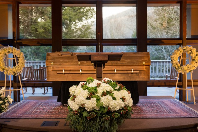 The body of Billy Graham—in a simple casket made of pine—rests behind a pulpit at The Billy Graham Training Center at The Cove in Asheville, N.C. The family felt the casket's placement was fitting since Graham spent most of his life preaching the gospel from behind a pulpit.