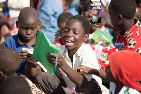 School supplies packed in shoebox gifts often offer children, like this young boy from the Malawi, access to the basic materials needed to attend school. - Americans Send School Supplies to Children Overseas