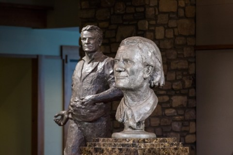 """Billy Graham as Messenger"" (in the foreground) and ""Billy Graham as Sower"" (in background) are displayed following the unveiling ceremony with Chinese artist Yuan Xikun and Billy Graham's son Franklin Graham."