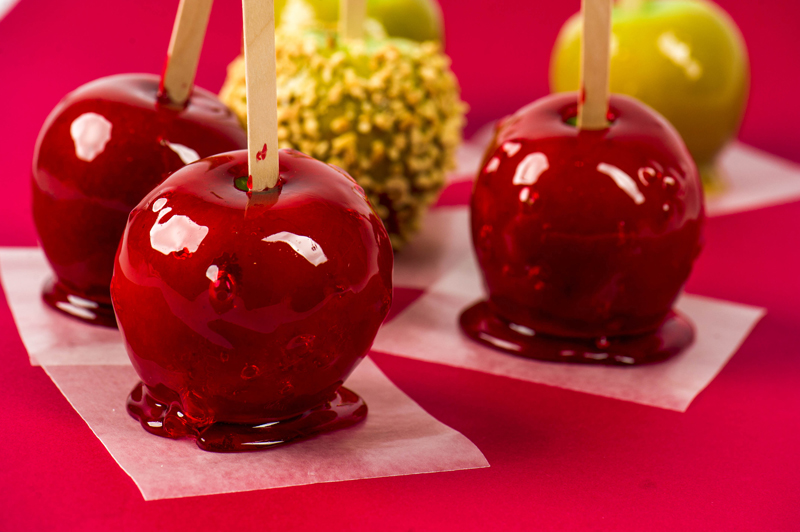 · Candy Apples: These are apples on a stick and coated with yumminess. There are red ones with a red glaze. Others are made with a caramel glaze. Sometimes nuts are added to those. Growing up, we had an neighbor, her church made the red candy apples for the fair and would bring my sister and I each one, each year.